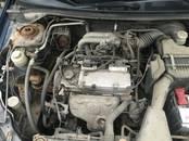Rezerves daļas,  Mitsubishi Lancer, Foto